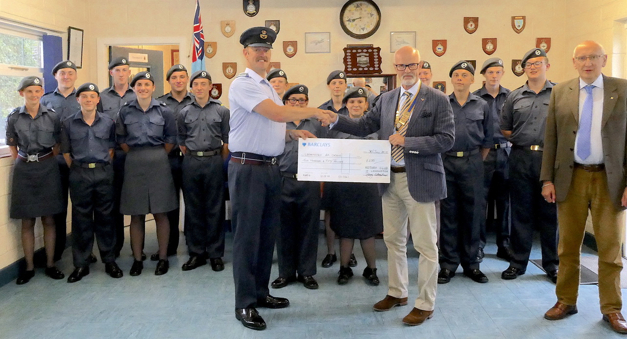 Flt Lt Martin Fulloway receives the cheque from Rotary President Ian Pedrick. Standing by is Rotarian Paul Davy.